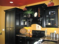 ~Kitchen with  Black Cabinets~, I just want to first start off that my kitchen is not a $100000 kitchen. We are still working on getting it how we wan know what you think! http://kelmayrn.blogspot.com/~The floors are stained concrete., ~~Thanks so much for ALL the positive comments. The paint colors : Breadbasket/Pittsburgh Paint(Walls)  Benjamin Moore /Rich Chestnut(Ceiling) Cabinets are custom. , Kitchens Design