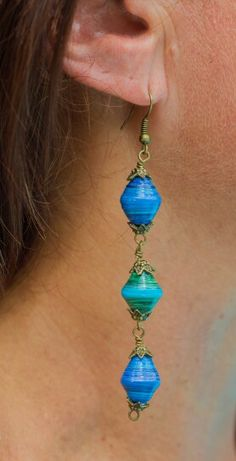 I would maybe wear something this long if I had the findings for it. We could make shorter versions too with only one or two beads. Paper Bead Earrings