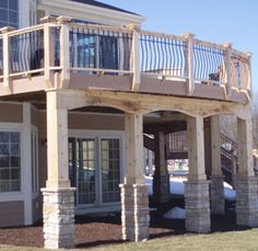 Planning a large deck off the end o  our house over the slider  Like how they dressed up the supports here... great idea!!