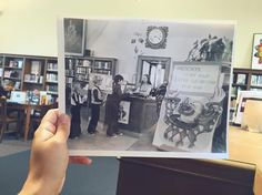 Happy world picture day! Picture of a picture: Suzanne, the head librarian in 1972, helping some children check out their books. Before the 2004 renovation, the front desk was located in the reading room! Besides the desk, almost everything else in the reading room has remained just as it did the day the library was built in 1916!