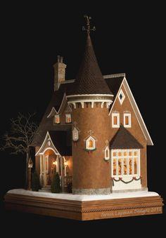 This is the Gingerbread Kitchen... my vision of the North Pole building where the elves live and work in a storybook style gingerbread house and spend their days creating the gingerbread houses for...