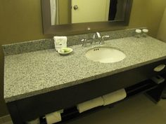 The counters in our newly renovated Concourse Premier Rooms are amazing! The shelf underneath for towels is so functional. Madison, Wisconsin Hotel.