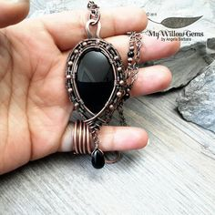 copper wire-wrapped necklace on brown leather cord. Cherry Quartz Pendant black onyx accent