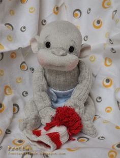 Here is another way to make a sock monkey. I'm giving you some hints. Employ your creativity.