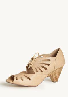 Lazer-cut peep toes in beige!