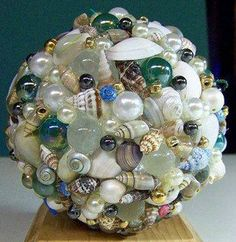 Add a few glass beads & marbles for subtle color. Seashell crafts for beach theme home decor
