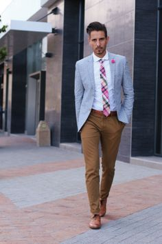 floral blazer, white shirt, pink tartan tie, pink lapel flower, tan leather belt, brown skinny chinos, tan brogues.