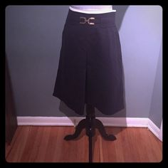 Ann Taylor skirt Adorable black skirt with white piping at the waist and gold detail at the waist (see pic). Pockets at the hips and front pleat. Zips up the back. Length is 24 inches. Faux pockets on the back. Ann Taylor Skirts
