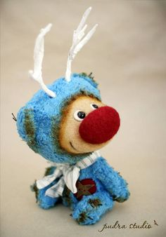 Jo (20 cm) was born from German cotton fur. He's got black glass eyes, needle felted face and a big red nose. :o) The boy wears a wired ribbon, rusty bells and has a wool heart with a metal star on his chest. .