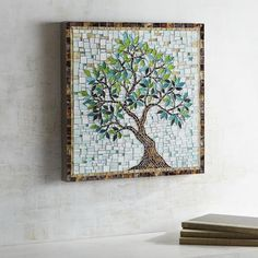 Much like small details come together to tell a story, each little mosaic plays its part in creating our tree of life wall art. Display it over your mantel or in a home office and notice how the contrast of rugged wood and smooth glass symbolizes the varied events that comprise life's journey.