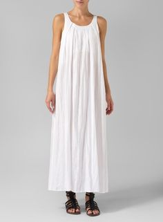 Simple beauty. Relaxed fit sleeveless dress gently drapes off the body for comfort during everyday activity.