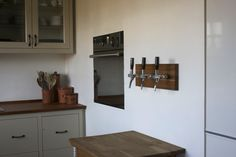 Beer taps in the kitchen.
