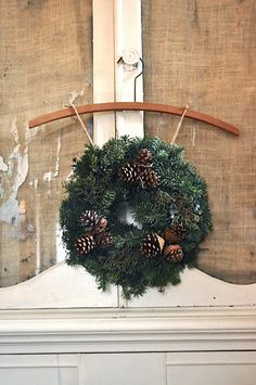 natural wreath hanging from coat hanger so pretty yet so simple
