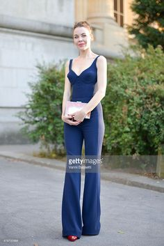 Designer Ulyana Sergeenko poses wearing an Ulyana Sergeenko dress and clutch after the Giambattista Valli show at the Grand Palais on July 6, 2015 in Paris, France.
