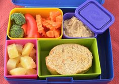 Provolone, spinach and tomato sandwich, with fruit, and a veggie and hummus side (plus 16 more vegetarian bento ideas!)
