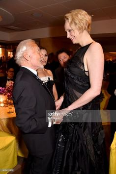 Astronaut Buzz Aldrin speaks with actor Gwendoline Christie attends at Golden Globe Awards After Party