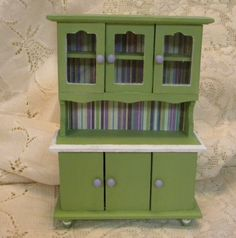 Green cupboard for kitchen bath or living room dollhouse miniature. $14.00, via Etsy.