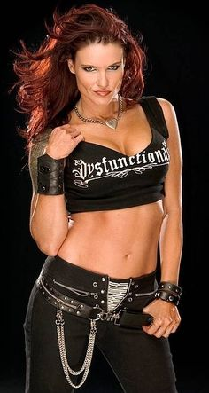 Former WWE diva Former WWE Woman's Champion Lita, 2014 inductee into the Hall of Fame. This woman kicked Ass, one of my favorite Divas in the WWE. Wrestling Stars, Wrestling Divas, Wrestling Superstars, Women's Wrestling, Wwe Lita, Wwe Total Divas, Wwe Female Wrestlers, Female Athletes, Trish Stratus