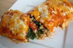Veggie Quinoa Enchiladas. Pretty tasty makes a massive amount.1 1/2 cups uncooked quinoa 1 onion, finely chopped 2 cloves garlic, finely chopped 1 red pepper, diced 2-3 roma tomatoes, diced 6 oz. spinach 4 oz. can green chiles 15 oz. can black beans, rinsed and drained 1/2 tsp. chili powder 1/2 tsp. cumin 1 tsp. oregano 1 cup salsa 2-3 cups enchilada sauce 1 1/2 cups shredded cheese 8 large tortillas