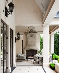 The wrought-iron lantern designed by architect Robbie Fusch and fabricated by Arte De Arquitectura De Mexico reinforces the home's French neoclassical vibe. Interior Exterior, Exterior Design, Porch Interior, Outdoor Rooms, Outdoor Living, Outdoor Kitchens, Outdoor Patios, Rustic Outdoor, Outdoor Lounge
