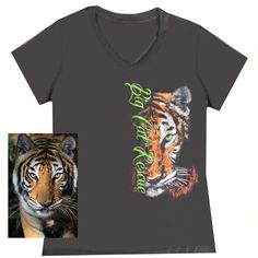 Women's v-neck tee features original artwork of China Doll the tiger and her intense gaze. Photo of China Doll above was inspiration for artwork design. Big Ca