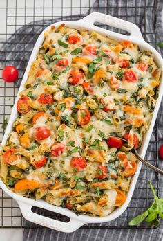 This creamy pasta bake from Well Plated combines whole wheat pasta noodles, golden sautéed chicken, and bright, bursting cherry tomatoes in a vibrant pesto sauce. A dish where comfort food and fabulously fresh intersect. Chicken Pesto Pasta Bake, Creamy Pasta Bake, Pesto Pasta Recipes, Bruschetta Chicken, Parmesan Recipes, Healthy Chicken Recipes, Lunch Recipes, Cheesy Recipes, Healthy Dinners