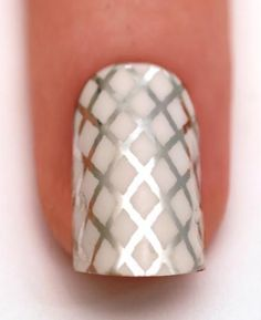 Simple Nail Art ~ silver cross hatching over a white base...x