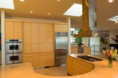Contemporary kitchen design with sleek cabinetry and a curved bar. Discovered on www.Porch.com Contemporary Kitchen Cabinets, Contemporary Kitchen Design, Modern House Design, Dream Kitchens, Kitchen Cabinet Design, Design Trends, Kitchen Remodel, Porch, Bar