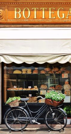 Produce in the front and back baskets in Bassano del Grappa, Italy