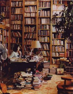 Nigella Lawson reading and writing in her home library. Photo from House and Garden.   Lawson (1960-) is an English food writer, journalist and broadcaster. Lawson is the daughter of Nigel Lawson, the former Chancellor of the Exchequer, and Vanessa Salmon, whose family owned the J. Lyons and Co. empire.   In 1998, Lawson brought out her first cook book, How to Eat, which sold 300,000 copies and became a best-seller. .http://books0977.tumblr.com/