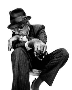 Leonard Cohen, looking gangster!:) he's always an impeccable dresser.