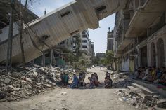 The Year in Pictures, 2014 - NYTimes.com GAZA CITY 08/15/2014 Palestinians prayed in the rubble of a mosque while a cease-fire with Israel was in effect. Wissam Nassar for The New York Times