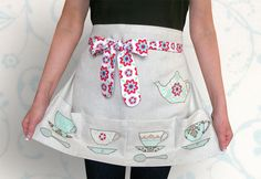 Tea Time Applique Apron. Tutorial: http://sew4home.com/projects/kitchen-linens/870-tea-time-kitchen-applique-pretty-pockets-half-apron-