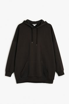 An oversize hoodie sweatshirt that vibes Brooklyn, NY circa '95. Note the hood's drawstring is threaded through two nifty silver eyelets. Ribbed around the bottom and at the wrists. Cotton-poly blend. colour: black magic In a size small the chest width is 142 cm and the length is 76 cm.