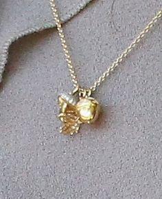 The Duchess is wearing a diamond acorn, a diamond oak leaf and a diamond mushroom from Asprey's Woodland collection