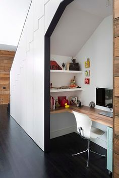Or even a workspace. | 27 Genius Ways To Use The Space Under Your Stairs