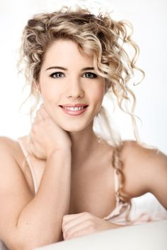 Emily Bett Rickards as Carline Pope
