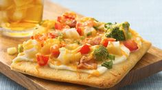 Enjoy the cheesy-bacon-broccoli combo you love in a top-the-tater pizza.