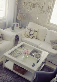 Livingroom Ikea Liatorp Coffee Table. Love the idea of putting big coffee table books under the glass.