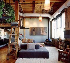 Ladder shelves, wood stove, sun spilling in, books.... cozy..... yes...