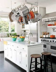 If you have the space, buy a rack to hang your pots and pans from the ceiling. Pot hangers are especially nice because they keep your pots and pans from getting scratched and they keep everything within arms reach.