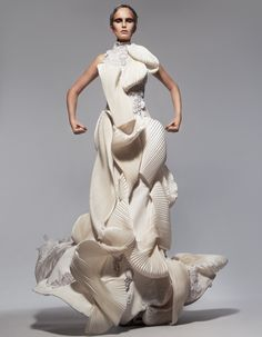 Fashion as Art - sculptural dress with beautifully twisted 3D pleat structures conveying a sense of fluidity & movement // Thom Browne