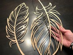 Experimenting with cutting some large feather shapes out of wood. I think these … Experimenting with cutting some large feather shapes out of wood. I think these will end up being beautiful if they are painted. Laser Art, Laser Cut Wood, Laser Cutting, Wood Laser Ideas, Cnc Cutting Design, Laser Cutter Ideas, Laser Cutter Projects, Cnc Projects, Metal Wall Art