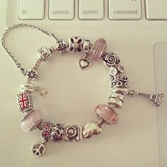 LOVE this bracelet w the Pink tones, but NOT A FAN of Muranos (Crystals) but should be on the silver charms instead <3