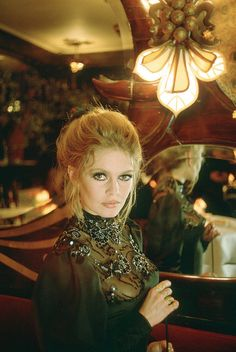 Brigitte Bardot wearing dress by ChristianDior, photo by Leonard de Raemy for French Vogue in 1969.