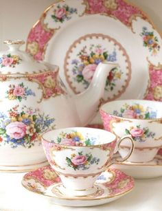 Lady Carlyle Vintage Tea Set - A classic example of the romantic, floral tradition of Royal Albert, the Lady Carlyle Collection draws inspiration from the extravagant rococo styles of the 18th Century. The pieces have a highly stylized floral design, a deep pink border & elaborate gold scroll work