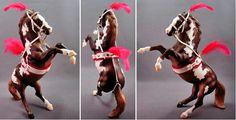 Model horse in circus costume