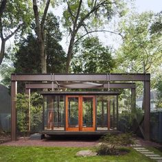A music recital room resembling a Japanese tea house hangs like a lantern in the garden of a residence northwest of Washington DC.