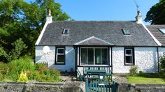 Burnside Cottage - a traditional,quaint self catering cottage set in a peaceful location of Sliddery. A great Arran hideaway. Sleeps 6. Pet Friendly. WiFi.
