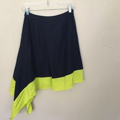 {Nordstrom} Trouve Color Block Skirt Summer go to with neon yellow and navy color block asymmetrical skirt. Has a liner and side zip with hook. Only wore twice. Excellent condition. Trouve Skirts Asymmetrical